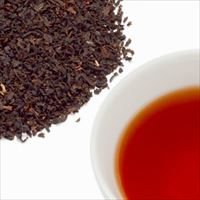 イングリッシュブレンドティーの茶葉と水色の写真