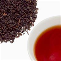セイロン・オレンジペコーティーの茶葉と水色の写真